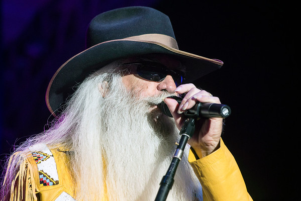 William Lee Golden of The Oak Ridge Boys kicks in on the harmony during a Sunday night concert at the Kentucky State Fair. 8/22/16