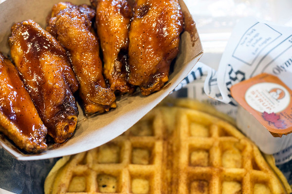 Five honey sriracha wings with a side waffle is one way to feed the appetite at Daddy Rich's. 1/4/17