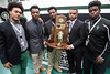 Trinity football players Robbie Lewis, Jovan Smith, Jovel Smith, Roderick Thomas, and Jermaine Jackson gather around their 2016 6A state title trophy during a celebration on Tuesday morning. 1/10/17