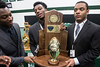 Trinity football players Jovan Smith, Jovel Smith and Roderick Thomas pose for family photos during a celebration of the school's 24th state title on Tuesday morning. 1/10/17