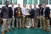 Members of the Trinity football team pose with the school's first state title trophy from 1968 and the 2016 state title trophy added to their collection of 24 on Tuesday morning. 1/10/17