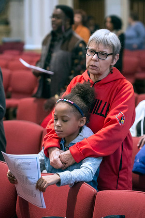 Cathy and Dani McKenzie read along during a service for MLK on Saturday at the Cathedral. 1/14/17