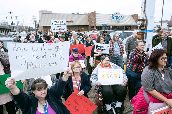 Makeshift signs peppered the landscape during a rally at the Old Louisville Kroger on 2nd Street as the neighborhhod prepares for the announced departure of the food chain. 1/21/17