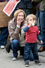 Dee Caudill and her grandson Vance Washburn listen to local leaders and community members during a rally at the 2nd Street Kroger on Saturday. 1/21/17