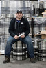 Great Flood Brewing Company co-owner Vince Cain sits on a stack of kegs ready to be shipped from the newly opened Shelby Park brewery. 1/21/17