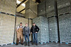 Great Flood Brewing Company co-owners Matt Fuller, Zach Barnes, and Vince Cain stand in front of a wall of beer ready to ship from their new Shelby Park brewery. 1/21/17