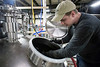 Zach Barnes cleans a kettle on the first day of brewing operations at the new Great Flood Shelby Park location. 1/21/17
