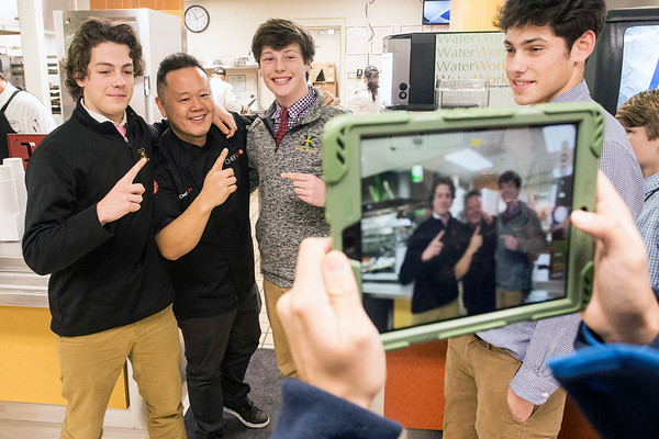St. X students Trey Sullivan and Patrick Daly take advantage of the photo opp with Food Network celebrity chef and restaurateur Jet Tila during his Monday visit to the school's cafeteria. 1/23/17