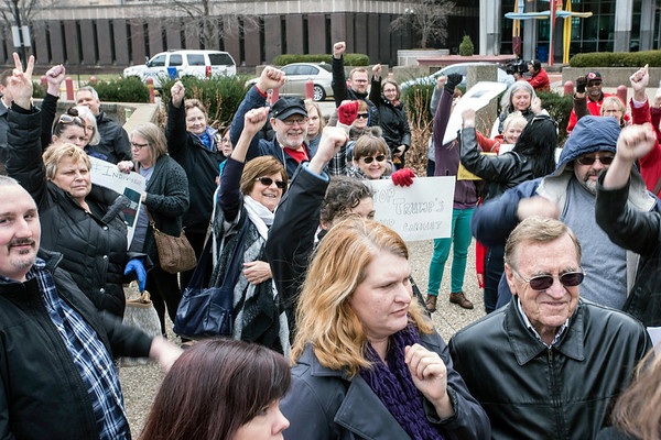 A collective show of defiant fists were lifted in the air at the conclusion of an anti-Trump rally in downtown Louisville on Tuesday morning. 1/24/17