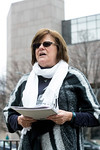 Rita Murray reads a letter penned by Jennifer Karman in opposition to the Trump nominee for Secretary of Education Betsy DeVos during a rally downtown on Tuesday morning. 1/24/17