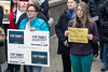 Lisa Duran and Lindsey L. Jones brought signs to a rally downtown on Tuesday to express the specific issues they have with Trump cabinet nominees. 1/24/17
