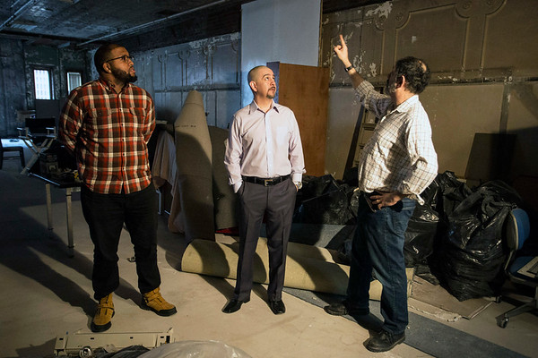 """James Reskin (right) breaks down plans for the conversion of space at 520 Fourth Street to producer Ricky """"Boom"""" Wiggington, Jr and studio owner Hugo Diaz. 1/29/17"""