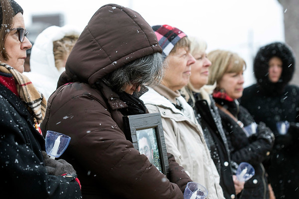 Around two dozen people gathered at the Big Four Station in Jeffersonville on Sunday for a candlelight vigil remembering the overdose victims of 2016. 1/29/17