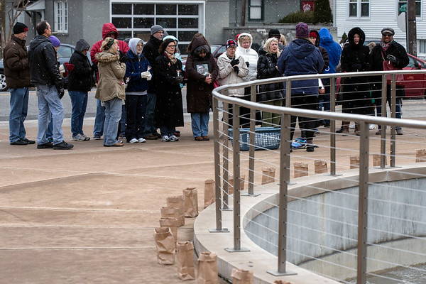 Candles wrapped around the base of the fountain at the Big Four Station on Sunday as Clark County's 89 drug overdose victims of 2016 were remembered. 1/29/17