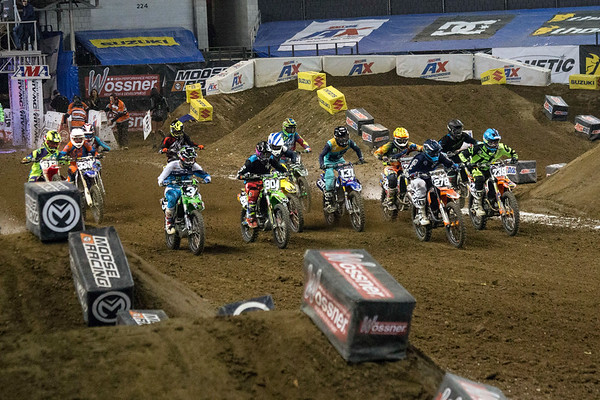 A pack of riders break from the starting gate during the 2017 AMSOIL Arenacross Tour in Freedom Hall on Saturday. 2/4/17