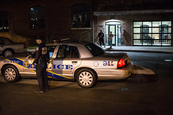 Police begin to clear the scene of a murder-suicide in the Germantown Mills Lofts on Goss Avenue Monday night. 2/6/17