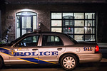 Police cruisers are parked near the rear entrance of the Germantown Mills Lofts in the 900 block of Goss Ave after two bodies were discovered late on Monday evening. Police indicated the cri ...