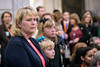 Norma Hatfield listens to speakers during Child Advocacy Day at the Kentucky State Capitol on Thursday morning alongside her granddaughter Kayla. 2/9/17