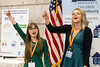 High school students Ellie Tarter and Emalee Patton lead a cheer for an audience assembled in the state capitol rotunda on Thursday morning for Children's Advocacy Day. 2/9/17