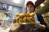Hi-Five Doughnuts co-owner Leslie Wilson works on a batch of yellow colored king cake doughnut holes for the upcoming Mardi Gras. 2/11/17