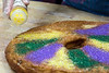 Multi-colored stripes of candy sprinkles are used to decorate a large doughnut as a king cake at Hi-Five Doughnuts. 2/11/17
