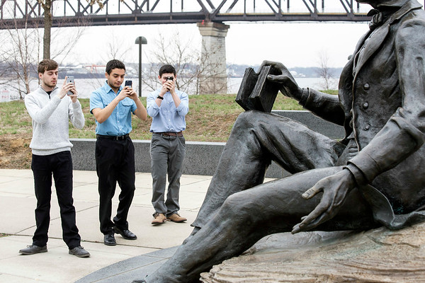 Bryan Stowers, Eli Gold, and David Carton of the touring vocal group known as the Hoosier A Capella took in the sights of Louisville's Waterfront Park on Saturday as the weather produced warmer than normal temperatures for February. 2/18/17