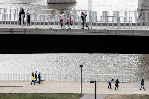 Pedestrians both high and low took advantage of the unseasonably warm weather and low winds on Saturday along the city's waterfront park spaces. 2/18/17