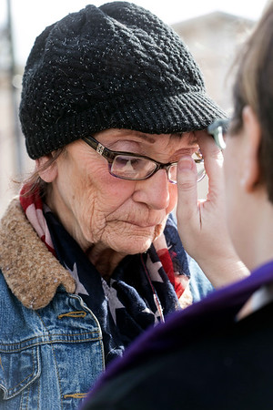 Judy Hulletta receives the traditional ash cross on her forehead at an Ashes to Go site in Jeffersonville on Wednesday as the Lent season began for Christians. 3/1/17