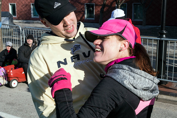 Coleman Coffey hugs sister Hallie after she completed the Anthem 5K on Saturday. 3/4/17