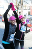 Brenda and Hallie Coffey celebrate after crossing the finish line of the Anthem 5K on Saturday. 3/4/17