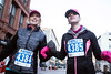 Brenda and Hallie Coffey spot the finish line on Main Street as they near the completion of the Anthem 5K on Saturday. 3/4/17