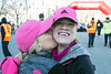 Hallie Coffey receives a congratulatory kiss from her mother Brenda after completing the Anthem 5K ahead of their expected time on Saturday morning. 3/4/17