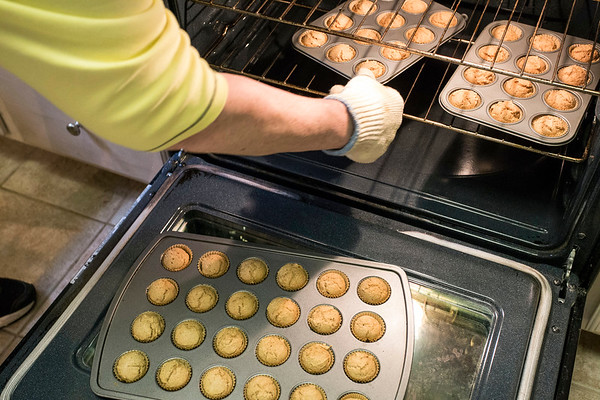 Pro baker Beth Schofield prepares another batch of her peanut butter pupcakes. 3/6/17