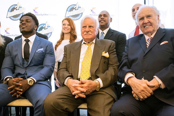 Michigan football player Jabrill Peppers is joined by Howard Schnellenberger and Paul Hornung for a photo before the annual Paul Hornung awards on Tuesday. 3/7/17