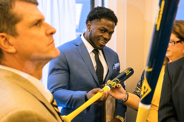 Michigan football player Jabrill Peppers and Michigan head coach Jim Harbaugh receive custom Louisville Slugger bats as part of the annual Paul Hornung awards at the Galt House on Tuesday night. 3/7/17