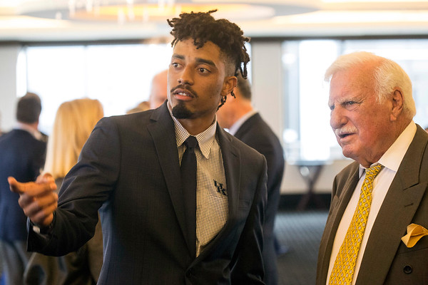 University of Kentucky quarterback Stephen Johnson chats with legendary college coach Howard Schnellenberger during a VIP reception at the Paul Hornung awards on Tuesday night. 3/7/17