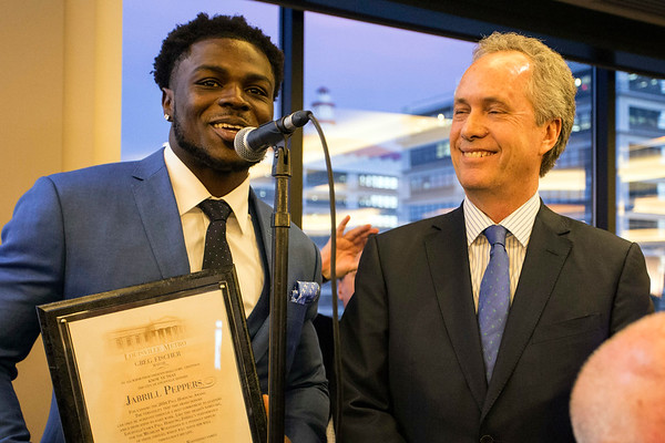 Mayor Greg Fischer welcomes Michigan football player Jabrill Peppers to Louisville during the annual Paul Hornung awards at the Galt House on Tuesday night. 3/7/17