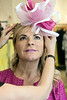 Rhonda Jo Conner tries on another one of milliner Christine Moore's creations at Rhodes for Her. 3/9/17