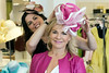 Rhonda Jo Conner tries on one of milliner Christine Moore's creations at Rhodes for Her. 3/9/17
