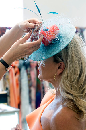 Rhonda Jo Conner waits while milliner Christine Moore makes minor adjustments during a recent fitting at Rhodes for Her. 3/9/17