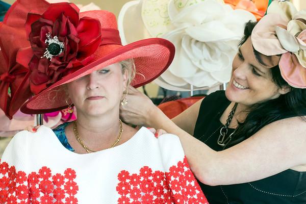 Milliner Christine Moore makes a few adjustments for Beth Scinta duirng a recent visit to Rhodes for Her. 3/9/17