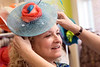 Beth Scinta finds a hat to her liking during a recent visit to Rhodes for Her. 3/9/17