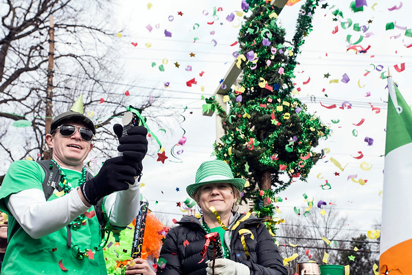 Paul Maron launches confetti into the air from atop a float in the St. Patrick's Parade on Saturday. 3/11/17