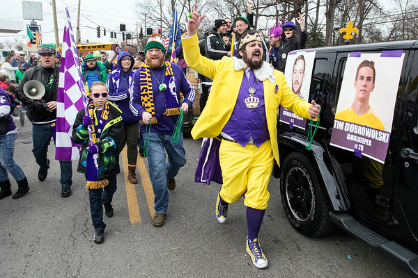 Fans and members of the Louisville FC marched with enthusiasm during the annual St. Patrick's Parade on Saturday. 3/11/17
