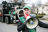 Jefferson County PVA Tony Lindauer offered Irish songs through a megaphone during the St. Patrick's Parade on Saturday. 3/11/17