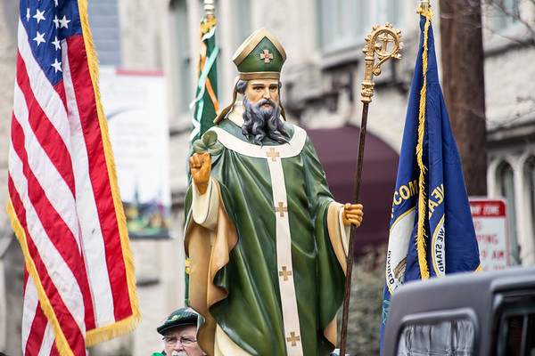 Flanked by the flags of America and Kentucky, a statue of St. Patrick rolled through the Highlands on Saturday as part of the annual St. Patrick's Parade. 3/11/17