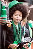 Andrew Hawkins gathered beads and candy tossed by passing floats on Baxter Avenue during the St. Patrick's Parade on Saturday. 3/11/17