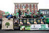 Elaborate floats decked in green and topped with festive riders rolled through the Irish bar district of Baxter Avenue during the St. Patrick's Parade on Saturday. 3/11/17