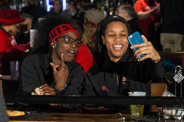 UofL basketball players Jazmine Jones and Asia Durr snapchat during an NCAA Tournament Selection Party at Fourth Street Live on Monday night. 3/13/17