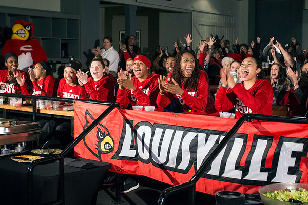 Members of the UofL women's basketball team react after being selected to the 2017 NCAA Tournament during a party at Fourth Street Live on Monday night. 3/13/17